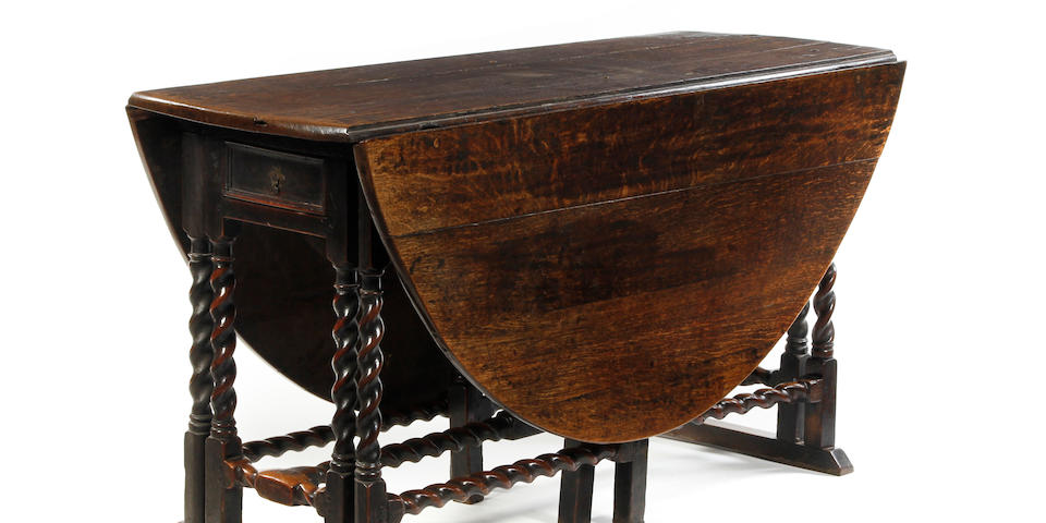 A rare Charles II oak double-action gateleg table With a rare and fine stretcher arrangement