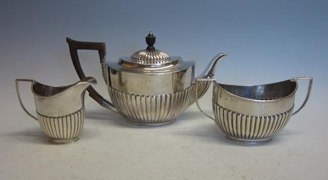 A Victorian composite three piece silver tea service,    London 1890, 1894,   (3)