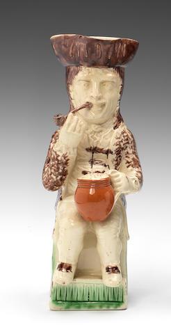 A Staffordshire creamware Thin Man Toby jug, circa 1780
