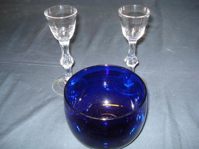 Two 18th Century facet stam wine glasses and a bristol blue finger bowl (3)