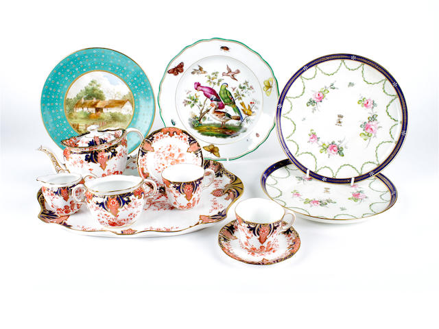 A Royal Crown Derby cabaret set and four plates, 19th and 20th century