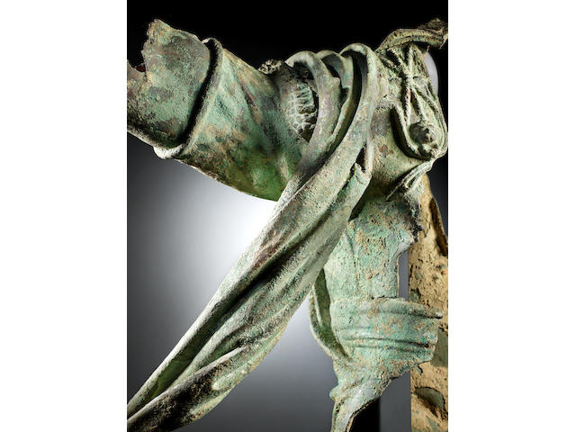 A Roman bronze statue fragment of an Emperor