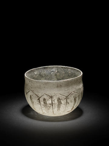 A Roman pale green glass wheel-abraded-decorated bowl