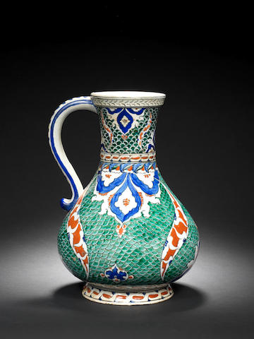 "An Iznik ""Fishscale"" composite pottery Jug Turkey, the base circa 1570, the neck with 19th Century French restoration, probably by Samson"
