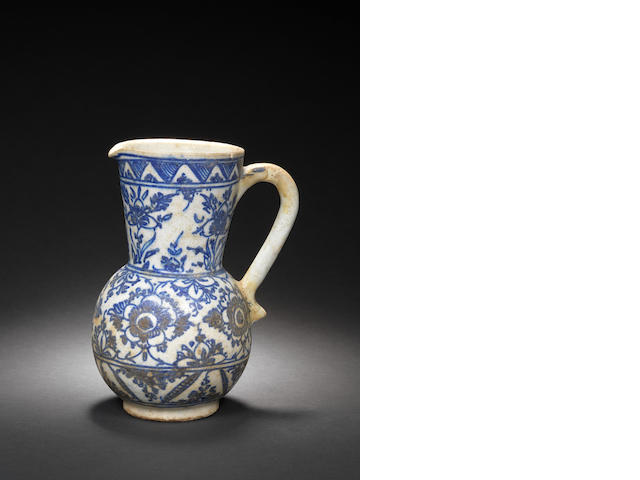 An Iznik-style blue and white pottery Jug Persia, 18th Century