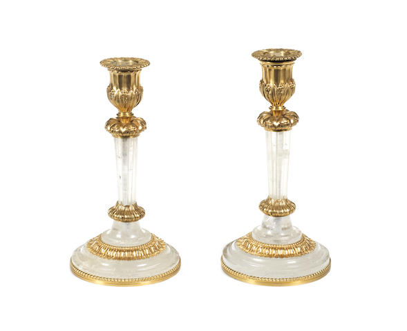 Two late 19th century rock crystal and gilt-bronze candlesticks