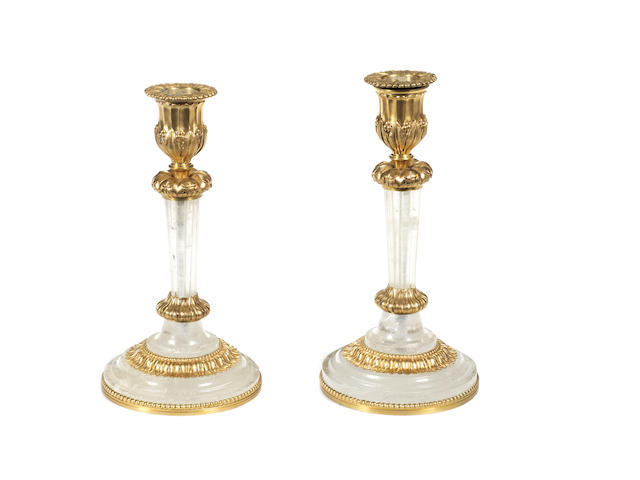 A pair of late 19th century rock crystal and gilt bronze flambeaux