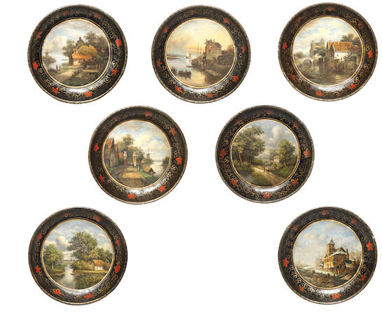 A set of seven Dutch late 19th century parcel-gilt and painted decorative plates