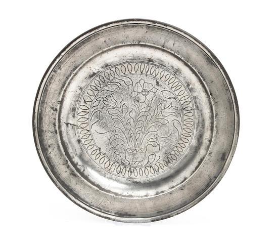 An unusual 18th century single-reed wriggle-work plate, circa 1730