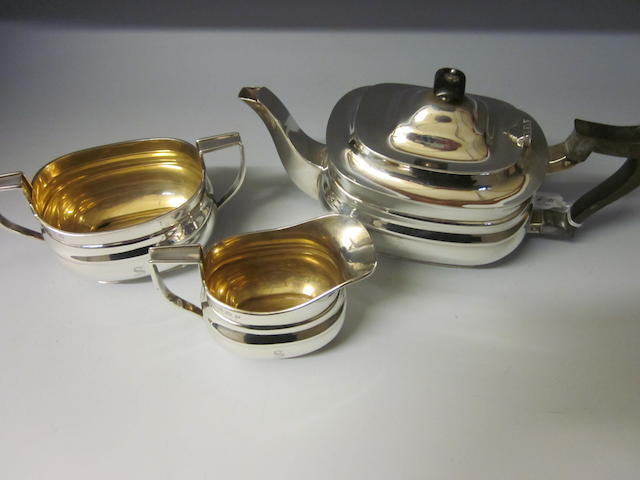 A silver three piece tea service,  by William Hutton and Sons Ltd,  Sheffield 1924,   (3)
