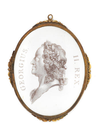 A Battersea enamel portrait medallion of George II, circa 1755