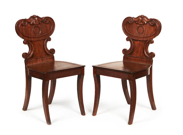 A pair of George IV mahogany hall chairs