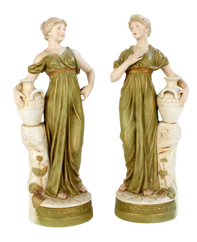 A pair of Royal Dux figures of water carriers, circa 1900