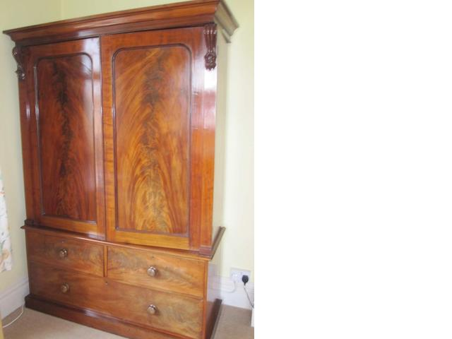 A large mid 19th century mahogany linen press/ wardrobe