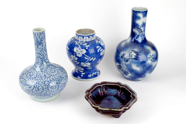 Three Chinese export blue and white vases and an earthenware sang-de-boeuf stand
