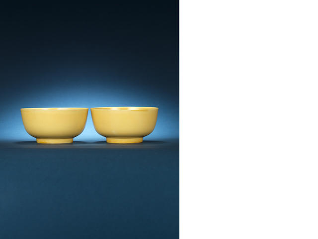 A pair of yellow-glazed bowls Kangxi six-character marks and of the period