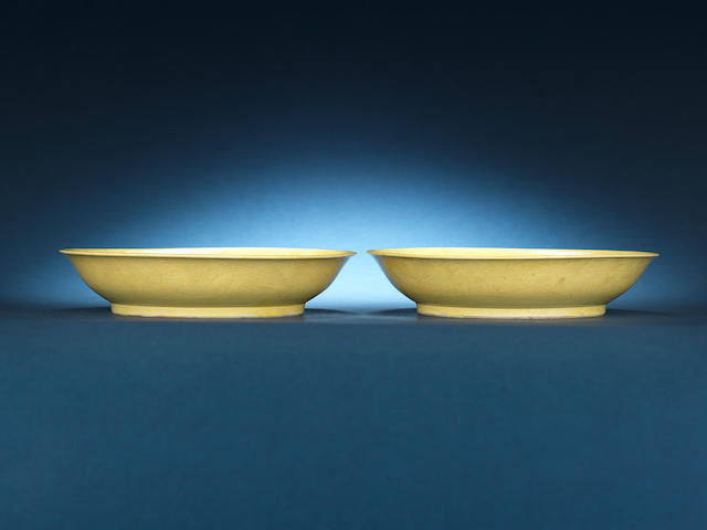 A pair of yellow-glazed 'dragon' dishes Xuande six-character marks, Kangxi