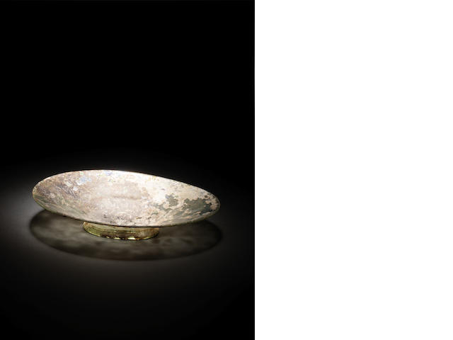 A Roman pale green glass oval dish