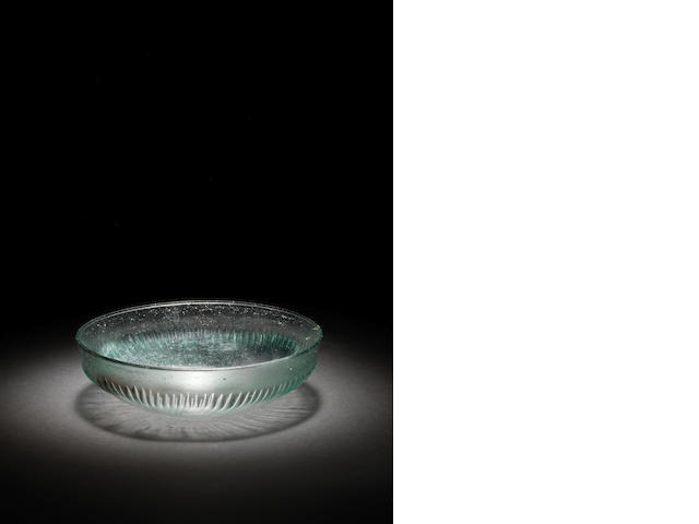 A Roman blue-green glass bowl