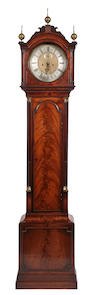 A Regency mahogany longcase clock, the dial signed Thomas Carter, London.