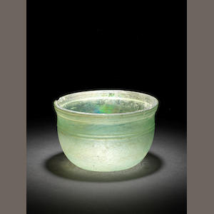A Roman green glass bowl