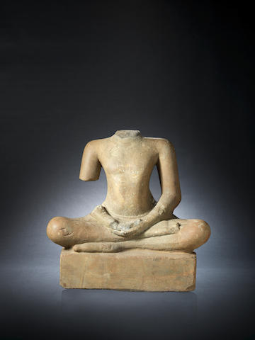 A Khmer grey sandstone carving of a seated figure in the Bayon Style, probably Jayavarman VII Cambodia, 12th Century
