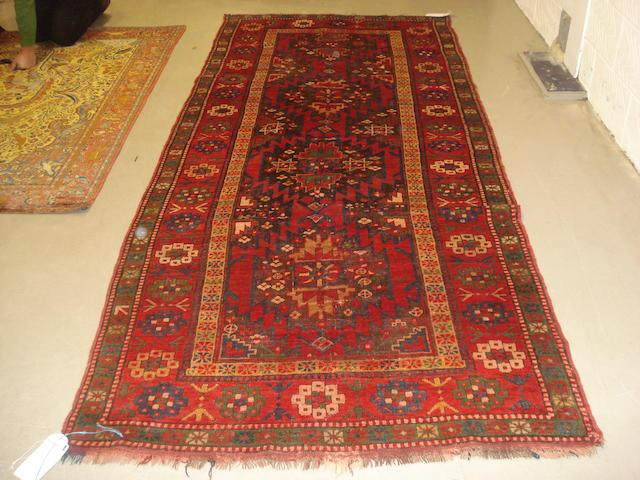 A Karabagh rug, South Caucasus, 313cm x 134cm