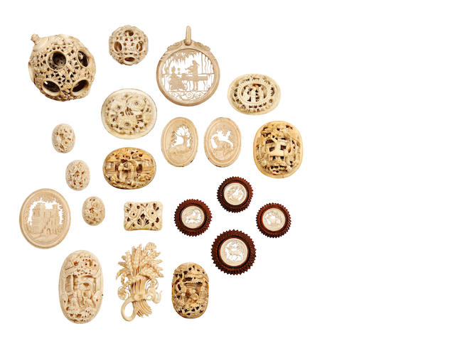 A group of thirty-two Chinese export ivory carvings and two puzzle balls, late 19th century