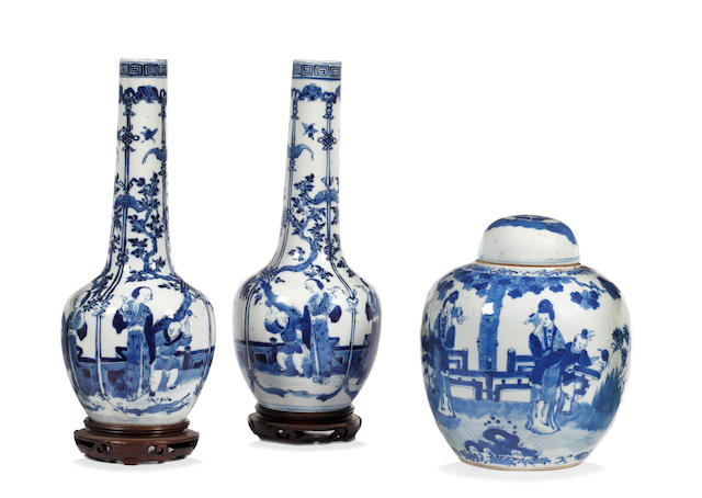 A pair of Chinese blue and white bottle vasesDecorated with figures of a terrace, 30cm and a blue and white ginger jar and cover. (4)