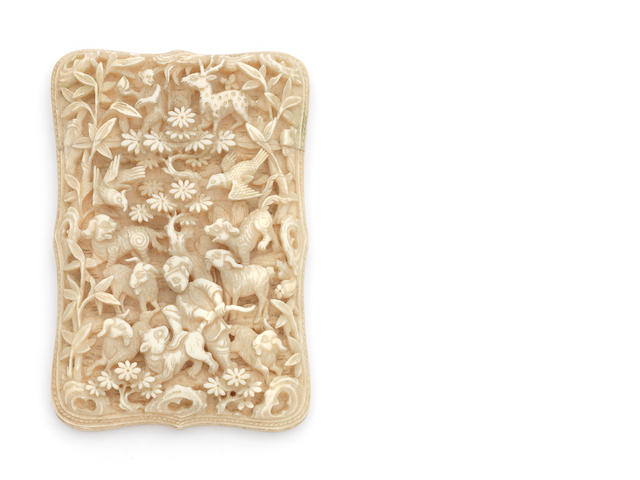 A late 19th century Chinese carved ivory card case decorated in relief