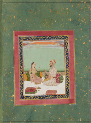 A prince and a maiden seated in conversation on a terrace Provincial Mughal, early 18th Century