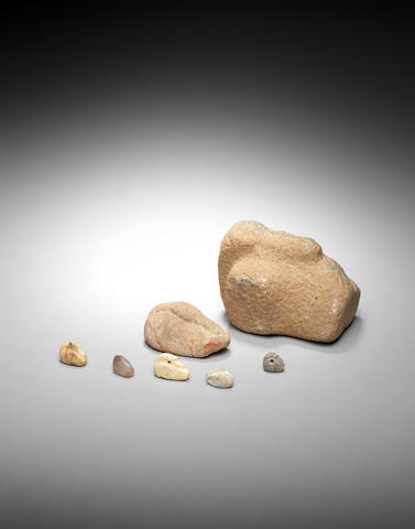 Two Ancient Near Eastern stone duck weights five Ancient Near Eastern hardstone duck seals, and four hardstone amulets and seals,