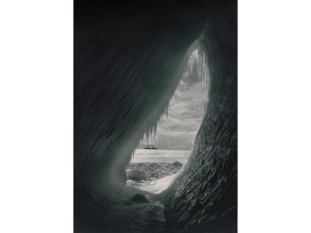 Herbert Ponting, Cavern in an iceberg with the Terra Nova in background, 1911