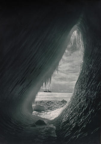 Herbert Ponting, Cavern in an iceberg with the Terra Nova in background, 1911
