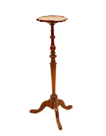 A late 19th century yew and walnut tripod torchere