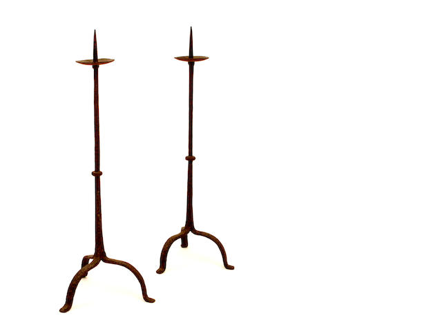 A pair of black painted wrought iron tripod pricket candlesticks, possibly 17th century