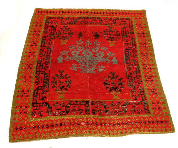 A Spanish rug 216 x 179cm.