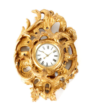 A George III style carved giltwood and parcel gilt cartel clock