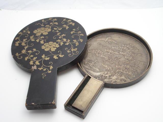 A bronze hand mirror