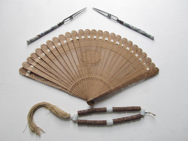 A pair of forks together with a sandalwood fan and necklace Late 19th century
