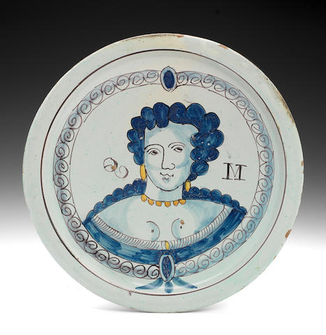 A fine Brislington delftware portrait charger of Queen Mary, circa 1689-94