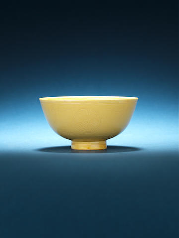 A fine yellow-glazed carved bowl Kangxi six-character mark and of the period