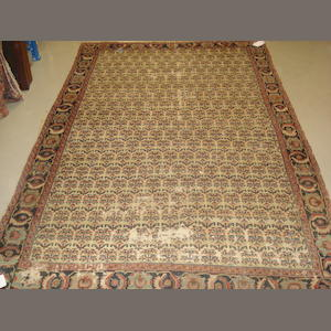 A North West Persian rug, 290cm x 191cm reduced in size
