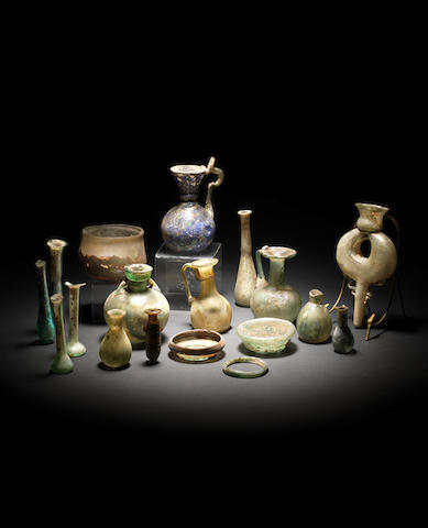 A group of seventeen glass vessels and an amber alabastron, 18