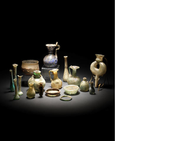 A group of seventeen miscellaneous glass vessels and an amber alabastron, 18