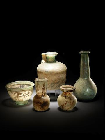 Five Roman green glass vessels 5