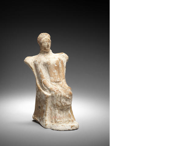 A Greek terracotta seated female figure
