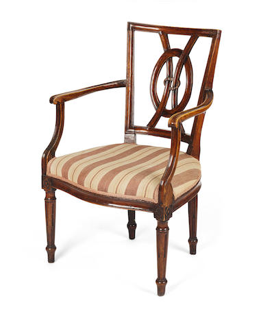 A pair of 18th century French provincial fruitwood armchairs