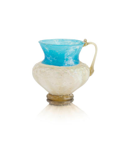 A small Persian two-colour glass jug 11th/12th century