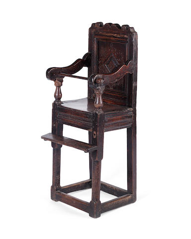 A 17th century oak child's high chair
